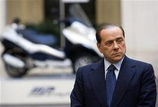 <p>Italy's Prime Minister Silvio Berlusconi arrives to present the new Piaggio Mp3 Hybrid scooter at Chigi palace in Rome May 28, 2009. REUTERS/Remo Casilli</p>