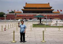 <p>A Chinese woman poses for a relative taking her photograph at Beijing's Tiananmen Square June 1, 2009. The Chinese government's refusal to release an official figure for the number killed on June 4, 1989, is symbolic of its larger silence about the crackdown on student protesters. China's economy is now the third-largest in the world, an achievement that would have been unthinkable during the impoverished 1980s. But political reform has stalled, with the Party quick to stamp out any perceived challenge. REUTERS/David Gray</p>