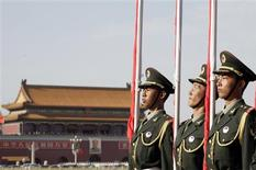 <p>Chinese soldiers carry red flags during a welcoming ceremony for Malaysia's Prime Minister Najib Razak outside the Great Hall of the People at Tiananmen Square in Beijing June 3, 2009. Chinese security forces blanketed Tiananmen Square on Wednesday ahead of the 20th anniversary of the June 4 crackdown on pro-democracy protesters, a day after Twitter and Hotmail Internet services in China were blocked. REUTERS/Reinhard Krause</p>