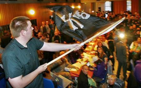 A supporter of Sweden's Pirate Party waves the Jolly Roger flag at an election night party as results are announced in EU Parliamentary elections in Stockholm June 7, 2009. REUTERS/Bob Strong
