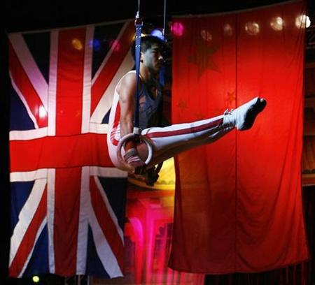 A gymnast from The Chinese State Circus is seen balancing on rings during a photocall for the Edinburgh Fringe Festival shows, Scotland August 6, 2008. REUTERS/David Moir