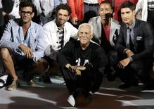 <p>Italian designer Giorgio Armani (C) poses for photographers with models after his Giorgio Armani Spring/Summer 2010 men's collection during Milan Fashion Week June 20, 2009. REUTERS/Alessandro Garofalo</p>