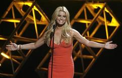 "<p>Singer Jessica Simpson is shown on stage introducing a performer at the taping of Country Music Television's special ""CMT Giants"" honoring Hank Williams, Jr. in Los Angeles October 25, 2007. REUTERS/Fred Prouser</p>"