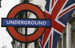 <p>A Union Flag flies near an underground sign for Westminster tube station in London March 31, 2009. REUTERS/Luke MacGregor</p>