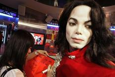 """<p>A visitor writes: """"June 26th we will remember """" on a condolence book next to a wax figure of Michael Jackson at Madame Tussauds Wax Museum in Shanghai June 26, 2009. REUTERS/Aly Song</p>"""