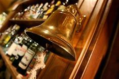 """<p>A traditional """"last orders"""" bell is seen behind a bar in London, November 23, 2005. REUTERS/Toby Melville</p>"""