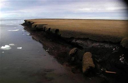 A handout photo from 2004 shows coastal erosion of mud-rich permafrost along on Beaufort Sea coastline Drew Point in Alaska. REUTERS/USGS/Gary Clow/Handout