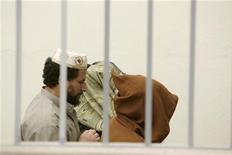 <p>Three suspects arrive at the court room in Sale near Rabat March 2, 2007. Morocco has shifted from mass arrests to tight surveillance in its fight against Islamic militants and hopes a new campaign to reinforce the authority of state-appointed imams will cut off support for jihadism. REUTERS/Rafael Marchante</p>