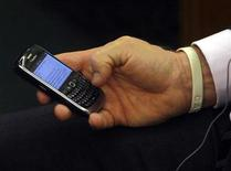 <p>Czech Republic's Prime Minister Mirek Topolanek sends a text message during the Nabucco Summit in Parliament in Budapest January 27, 2009. REUTERS/Karoly Arvai</p>