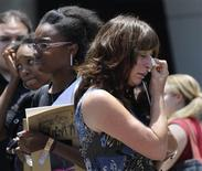 <p>Kelly Hornback (R) wipes away tears following a memorial service for Michael Jackson held in Los Angeles, July 7, 2009. REUTERS/Phil McCarten</p>