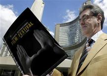 <p>Toronto International Film Festival Director and Chief Executive Officer Piers Handling looks over the final programme for the 30th annual festival at a Nathan Phillips Square press conference in Toronto, August 23, 2005. REUTERS/Mike Cassese</p>