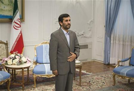EDITORS' NOTE: Reuters and other foreign media are subject to Iranian restrictions on leaving the office to report, film or take pictures in Tehran. Iranian President Mahmoud Ahmadinejad waits for Oman's Foreign Minister Youssef bin Alawi bin Abdullah before an official meeting in Tehran July 11, 2009. REUTERS/Morteza Nikoubazl