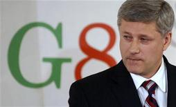 <p>Canada's Prime Minister Stephen Harper pauses during a news conference at the end of the G8 summit in L'Aquila, Italy July 10, 2009. REUTERS/Chris Wattie</p>