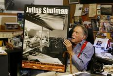 """<p>Julius Shulman, noted architectural photographer, holds a poster featuring one of his most famous photographs, """"Case Study House No. 22"""", during an interview at his home in Los Angeles in this June 27, 2008 file photo. REUTERS/Fred Prouser/Files</p>"""
