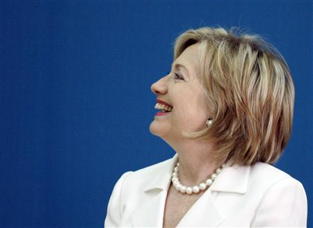Secretary of State Hillary Clinton reacts before addressing India's students and university officials during a function at a university campus in New Delhi, July 20, 2009. REUTERS/Fayaz Kabli