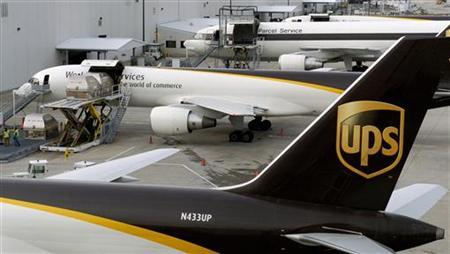 A United Parcel Service Inc. aircraft is loaded with air containers full of packages bound for their final destination at the UPS Worldport All Points International Hub in Louisville, Kentucky December 20, 2006. REUTERS/John Sommers II