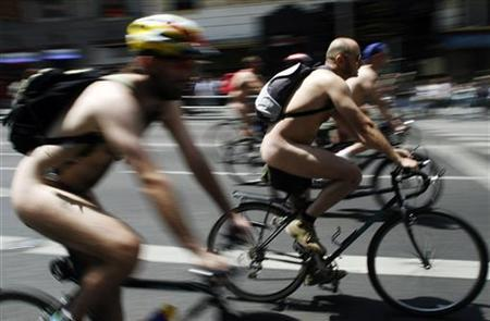 Naked cyclists take part in a protest through central Madrid, June 9, 2007. REUTERS/Susana Vera
