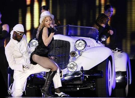 U.S. singer Madonna performs during her Sticky and Sweet tour at Lluis Companys stadium in Barcelona July 21, 2009. REUTERS/Albert Gea