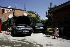 <p>A member of the Akrikez family plays in her home's courtyard at La Canada Real shanty town, on the outskirts of Madrid, July 10, 2009. REUTERS/Francisco Seco</p>