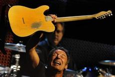 "<p>Bruce Springsteen performs with the E. Street Band on the first night of the Spanish leg of a U.S. and European tour to promote their latest album ""Working on a Dream"", at the San Mames stadium in Bilbao July 26, 2009. REUTERS/Vincent West</p>"
