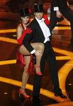 <p>Singer Beyonce Knowles performs with show host Hugh Jackman during the 81st Academy Awards in Hollywood, California February 22, 2009. REUTERS/Gary Hershorn</p>