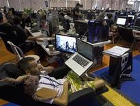 """<p>People surf the web during the annual """"Campus Party"""" Internet users gathering in Valencia July 28, 2009. REUTERS/Heino Kalis</p>"""