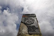 <p>An East German border stone is pictured at the former east German border in the village of Moedlareuth, about 300 kilometres (186 miles) south of Berlin, July 24, 2009. REUTERS/Fabrizio Bensch</p>