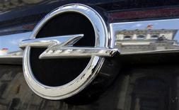 <p>The Reichstag building, seat of the German lower house of Parliament Bundestag, is reflected in an Opel car emblem in Berlin, August 4, 2009. REUTERS/Tobias Schwarz</p>