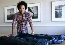 <p>Patrick Robinson, head designer for Gap, Inc., poses for a photograph with denim jeans in Santa Francisco, California, August 5, 2009. Gap Inc, once the go-to U.S. retailer for jeans, is betting on a major revamp of its self-branded denim line to revive its cachet and sales. Picture taken August 5, 2009. REUTERS/Robert Galbraith</p>