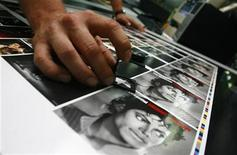 <p>A worker checks freshly printed covers of Michael Jackson's 'The Essential' CD in the Austrian 'ArtPress' factory in Hoefen July 3, 2009. REUTERS/ Dominic Ebenbichler</p>