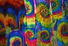<p>T-shirts on sale are displayed near the site of the original Woodstock Music Festival in Bethel, New York August 14, 2009. REUTERS/Eric Thayer</p>