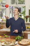 <p>Figure skater Brian Boitano prepares a dish during a cooking show in this undated handout photo. REUTERS/Courtesy Food Network</p>