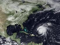 <p>Hurricane Bill is pictured moving in the Altantic Ocean in this satellite image taken August 20, 2009. REUTERS/NOAA/Handout</p>