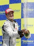 <p>Barrichello conquistou a centésima vitória de um piloto brasileiro na F1 em Valência neste domingo. REUTERS/Albert Gea</p>