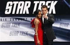 """<p>Actors Zoe Saldana (L) and Chris Pine pose on the red carpet during the German premiere of the movie """"Star Trek"""" in Berlin, April 16, 2009. REUTERS/Fabrizio Bensch</p>"""