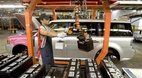 <p>A worker prepares to install a battery into a Ford Flex on the assembly line at the company's Oakville Plant in this June 3, 2008 file photo. REUTERS/Fred Thornhill</p>