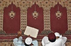 <p>A man reads Koran at a mosque in Larkana on August 23, 2009. Pakistani Muslim observe the first day of Ramadan on Sunday, the Islamic holy month when Muslims fast from dawn until dusk. REUTERS/Nadeem Soomro</p>