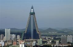 <p>Ryugyong Hotel is seen in Pyongyang in this picture taken August 28, 2009. REUTERS/The Korea Sharing Movement/Handout</p>