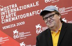 <p>U.S. director Michael Moore poses during a photocall at the 66th Venice Film Festival September 6, 2009. Capitalism is evil. REUTERS/Tony Gentile</p>