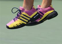 "<p>Melanie Oudin of the U.S. wears shoes bearing the message ""BELIEVE"" while serving to Nadia Petrova of Russia during their match at the U.S. Open tennis championship in New York, September 7, 2009. REUTERS/David Gray</p>"