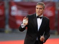 """<p>Actor George Clooney poses for photographers during a red carpet for the premiere of the movie """"The Men Who Stare At Goats"""" at the 66th Venice Film Festival September 8, 2009. REUTERS/Tony Gentile</p>"""
