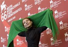 """<p>Director Hana Makhmalbaf poses during a photocall of """" Ruzhaye Sabz"""" (Green Days) during the 66th Venice Film Festival September 11, 2009. REUTERS/Alessandro Bianchi</p>"""