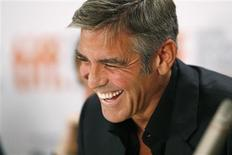 "<p>Cast member George Clooney laughs at a news conference for ""The Men Who Stare at Goats"" during the 34th Toronto International Film Festival on September 11, 2009. REUTERS/Mario Anzuoni</p>"