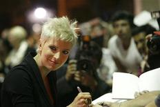 """<p>Diablo Cody, writer of """"Jennifer's Body"""", signs autographs at the gala screening of the movie during the 34th Toronto International Film Festival, September 10, 2009. REUTERS/Mario Anzuoni</p>"""