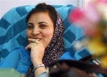 <p>Sakina Itoo, Kashmir's minster for Social Welfare, smiles during an interview with Reuters at her office in Srinagar September 14, 2009. REUTERS/Fayaz Kabli</p>