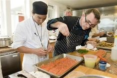 <p>Chef Rick Moonen prepares a meal in this undated handout photo. REUTERS/Terrance McCarthy of TMC Photography/Handout</p>