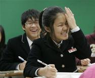 <p>Middle school students, who are North Korean defectors, react as they take part in a history class at the Hangyeore middle and high school in Anseong, about 80 km (50 miles) south of Seoul, November 21, 2008. REUTERS/Jo Yong-Hak</p>