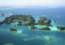 <p>An aerial view of islands in Palau in this undated photo. Palau, a nation of sparsely populated Pacific islands surrounded by turquoise waters teeming with fish and giant clams, is so obscure most people must scour a map to find it. But with a crop of high-end resorts coming up, the islands may soon become a luxury tourist hotspot. REUTERS/Jackson Henry</p>