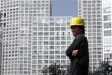 <p>Immagine d'archivio di un lavoratore migrante. REUTERS/Grace Liang (CHINA EMPLOYMENT BUSINESS CONSTRUCTION)</p>