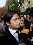 <p>Nelson Piquet, ex-piloto da equipe Renault de F1, chega para audiência na FIA, em Paris. Nelsinho Piquet afirmou que ainda sonha em ser campeão da Fórmula 1 e negou que tenha partido dele a ideia de bater de propósito no Grande Prêmio de Cingapura de 2008 para manipular o resultado da corrida.21/09/2009.REUTERS/Gareth Watkins</p>